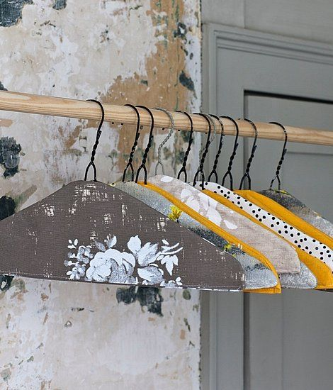 Cut Out + Keep turns less-than-lovely wire hangers into works of domestic art with a little fabric.