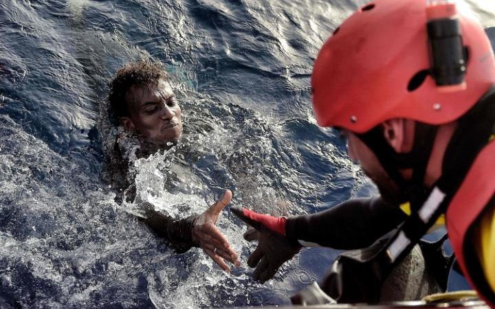 "A migrant is rescued from the mediterranean sea by a member of Proactiva Open Arms NGO some 20 nautical miles north of Libya. Thousands of migrants are ""racing against the clock"" to make the perilous crossing from Libya to Europe before summer ends, with authorities in the conflict-torn country at a loss to stem the flow."