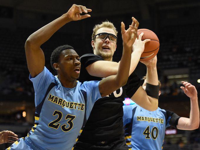 Marquette Golden Eagles guard JaJuan Johnson (23) tries