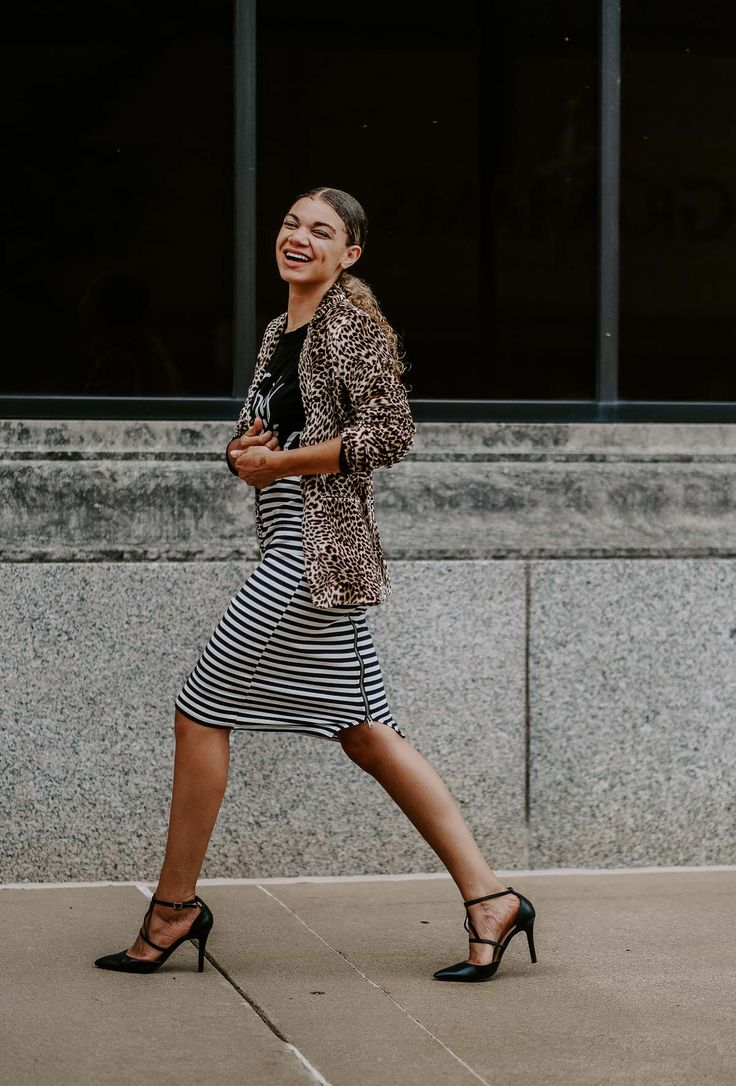 Leopard print blazer outfit with a slicked back curly hairstyle with naturally c…