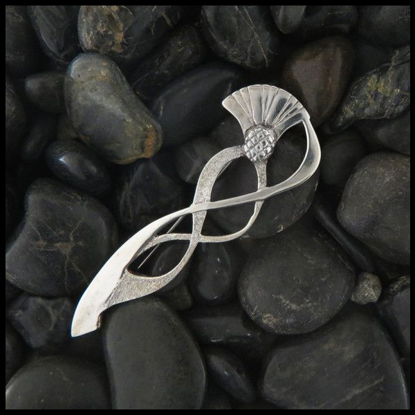 The Sterling Silver Kilt Pin with Thistle is inspired by Scottish heritage and celtic design. This bold and graceful pin would look wonderful on both a man,s and woman's kilt. Item number: KP59 Origin