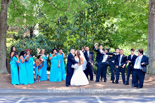Love how the couple very romantic kissing and the bridal party going crazy!