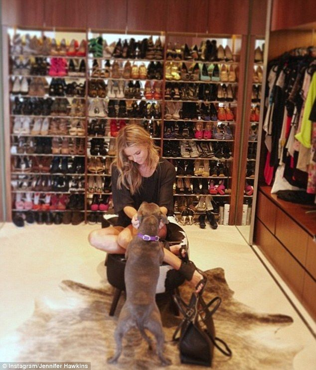Designer dreams: Model Jennifer Hawkins gave her fans a inside look at her fabulous footwear collection on Thursday- No clue on who she is but I'm a fan of her shoe closet.