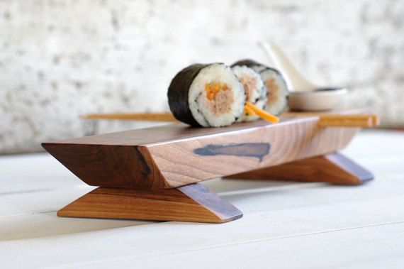 Something so delicious and beautiful as Sushi deserves a plate that really emphasizes this Japanese delicacy. Well, those Walnut-wood serving platters definitely qualify for that purpose!  This very stylish and minimalist Sushi set comes with 1 set of hand turned Cherry wood chopsticks per board too.  Ive hand rubbed this nicely curved platter with biological grape seed oil. Made from locally obtained European Walnut wood.  Its my pleasure, to create my boards with the use of very, very…