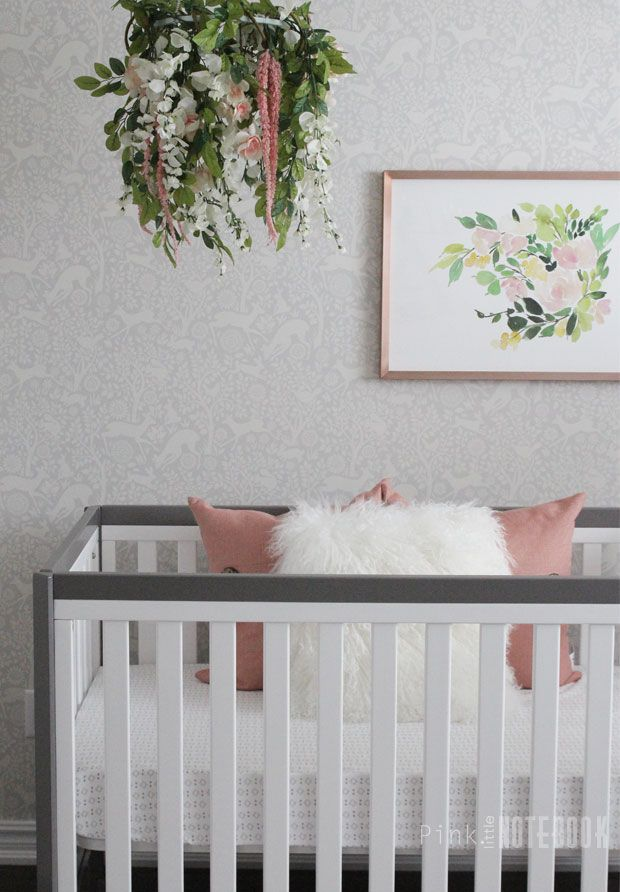 Baby Girl's Whimsical Nursery | Pink Little Notebook. Find items here---> CRIB: http://amzn.to/28SxUiG / WALLPAPER: http://amzn.to/28SxFUU / FLOWER ART: http://shrsl.com/?~cxx3   #affiliatelink