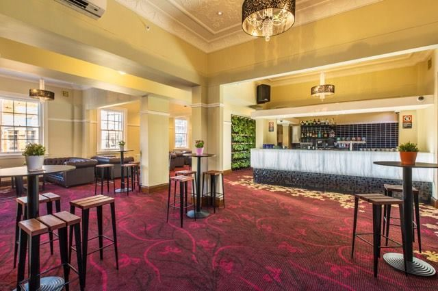 Bar features Marblo Ice Cap Grey & Glacier.  Bars throughout the Crows Nest Hotel also feature our Marblo Glacier.