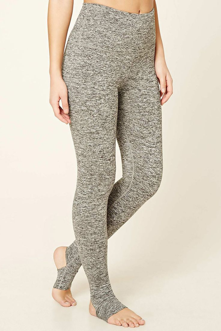 A pair of heathered knit stirrup leggings featuring a high elasticized waist, heel cutout, a hidden key pocket, and a thin fleece lining.