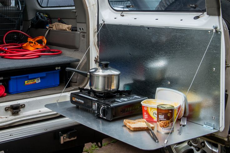 Simplicity is always the best choice. Well done camp table on the swingout rear door. nissan-patrol-door-table-diy-4wder
