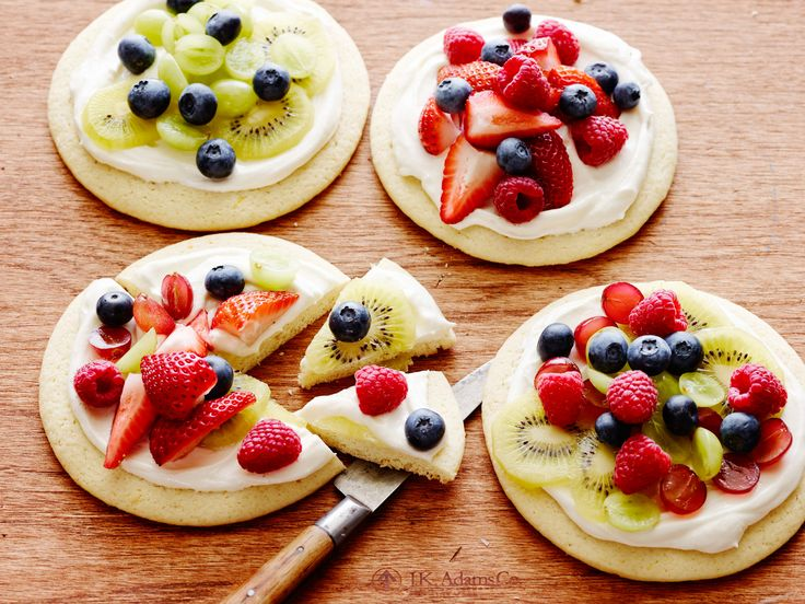 Individual Fruit Pizzas : Ree Drummond tops homemade cookie crusts with a creamy mixture and displays them with a platter of fruit. Let everyone build their own pizza with as much fruit as desired for a treat that's perfect for a sleepover or any kid-friendly event. via Food Network
