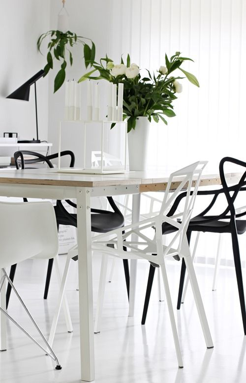 Mix Of Designer Chairs In Black And White: Eames DSR, Kartell Master Chair  * By Larsen Kubus * Louis Poulsens AJ Lamp