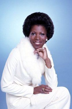 """Roxie Roker received a B.F.A. degree in drama from Howard University in 1952 where she was an active member of the Howard Players and was initiated into the Alpha Chapter of Alpha Kappa Alpha Sorority. She began her career with the renowned Negro Ensemble Company. She is best known for her role as """"Helen Willis"""" on the television show, The Jeffersons. She also appeared in the film Claudine.She is the mother of Lenny Kravitz."""