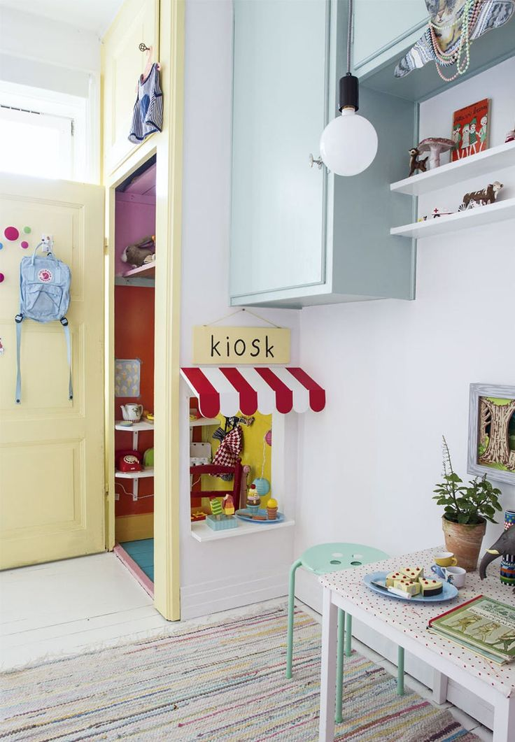 DIY-idea for the kids play area - transform an old closet into a small boutique, kiosk or similar. Perfect for playtime!