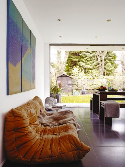Love everything about this white walls slate floors large window open concept and camel - Togo ligne roset ...