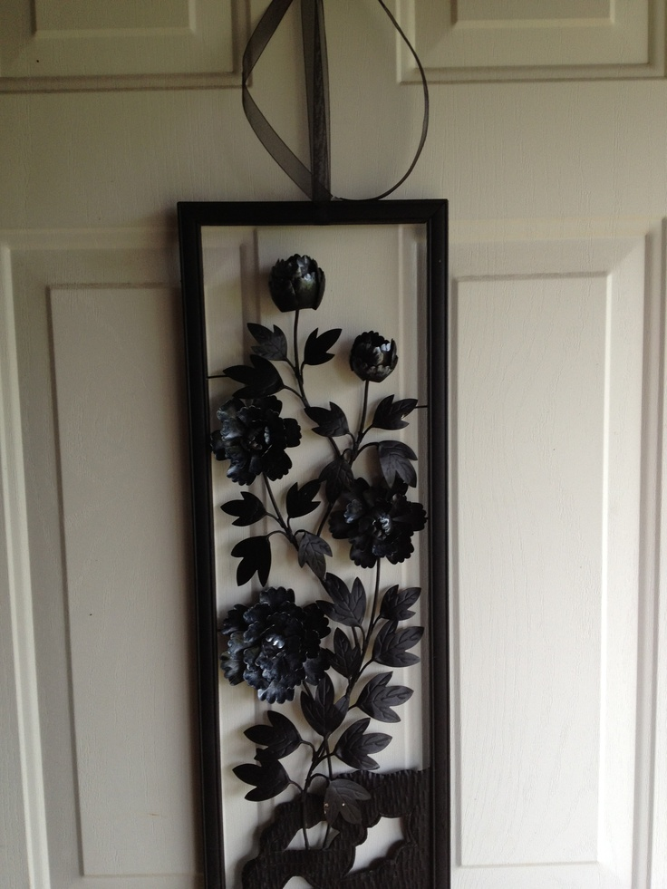 Quick Idea For Front Door Decor. Old Metal Wall Hanging From Thrift Store.  Freshened Up With Shimmering Paint Black Ribbon.