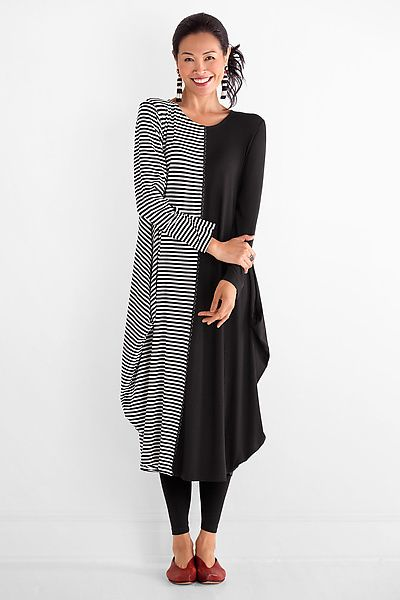 Free-spirited and fun, this dress is simply captivating! Contrasting striped and solid fabrics make a bold statement in a classic black and white palette. Carousel Dress by Spirithouse