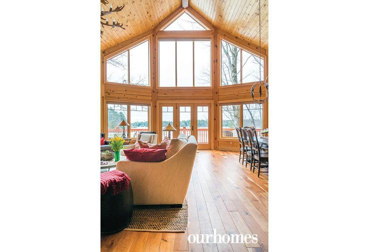 """High windows in the great room of this family cottage overlook Echo Bay and the Moon River.    See more of this home in """"Fifth Generation Legacy on Muskoka's Moon River"""" from OUR HOMES Muskoka Early Summer 2017: http://www.ourhomes.ca/articles/build/article/fifth-generation-legacy-on-muskokas-moon-river"""