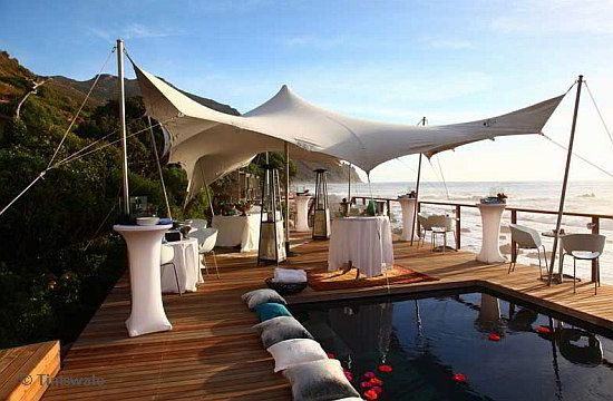 A world class exclusive beach wedding venue in Cape Town is the intimate Tintswalo Atlantic lodge.