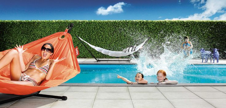 Lounging by the pool on a hot day with the Fatboy Headdemock, Orange