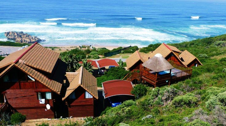 Overview of Brenton on Sea Chalets - perched on the side of the hill with endless sea views