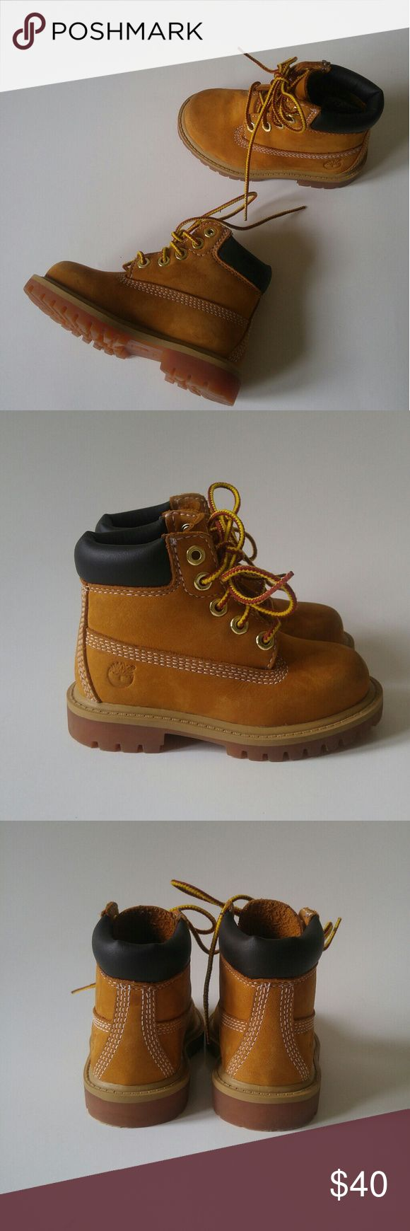 """Timberland 6"""" Premium Waterproof Toddler Boots Timberland kid's boots # 12809 Boy's toddler size 6. Waterproof leather upper with a padded collar for comfort.  Rubber sole with lugged traction pattern.  Overall good condition- some wear at toes, inner side of left shoe, bottom and inner sole are barely worn. See all photos for condition!  *I offer 10% off bundles of 2+ items!* Timberland Shoes Boots"""