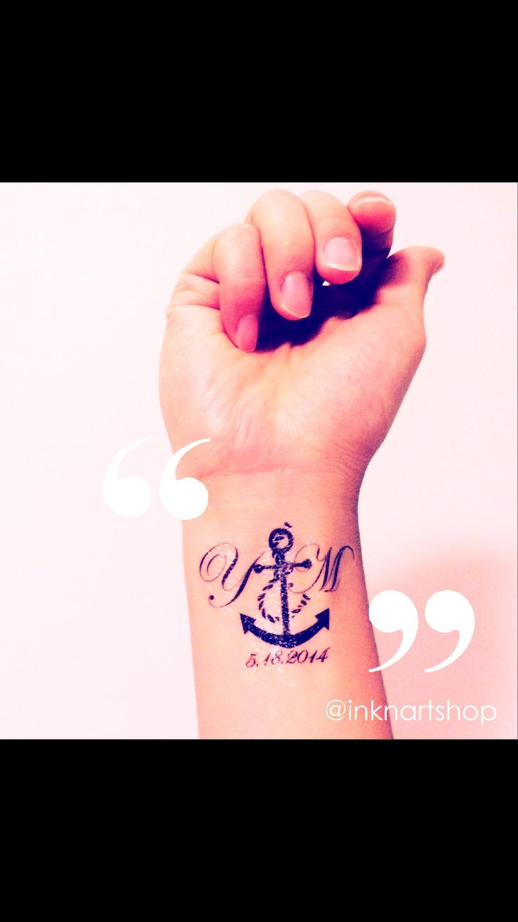 Anchor with initial tattoo