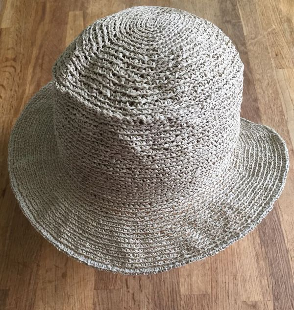 This isn't the party favor or newspaper-play hat., this is a practical hat for the heliophobic. Fair skinned folks who are allergic to sunscreen need summer hats. I decided to crochet one last year, finishing it en route to Hawaii....
