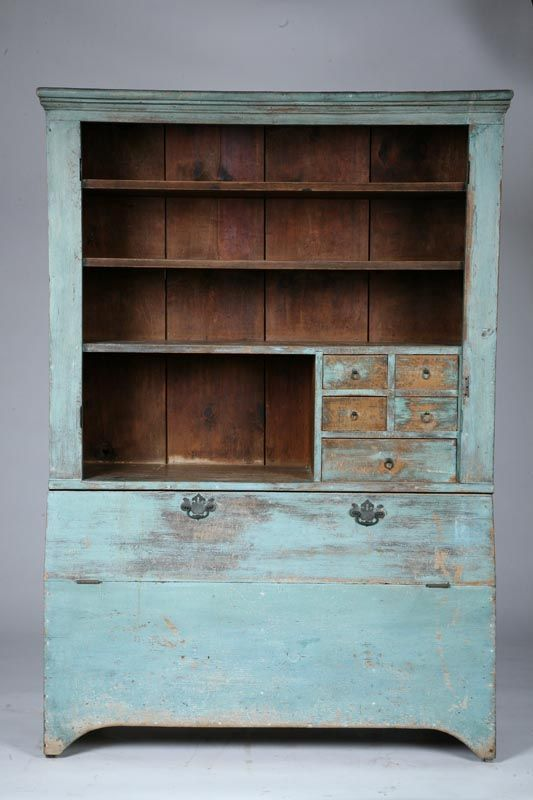 "UNUSUAL WALL CUPBOARD.   American, 19th century, pine. One-piece cupboard with shelves and small drawers in the upper section and divided bins in the lower section. Retains old, grungy, dry blue paint. Imperfections. 76 1/2""h. 52'w. 20""d. Ex Tom and Carolyn Porter (Ohio), sold at Garth's, November 26-27, 2004, lot 409."