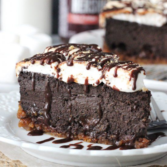S'mores Cheesecake - a thick and creamy chocolate cheesecake, melty toasted marshmallows and graham cracker crust