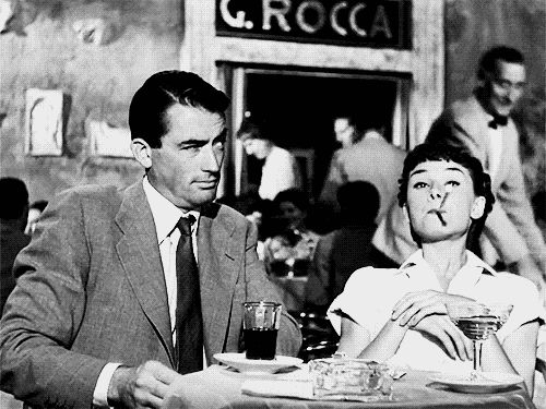 "Gregory Peck , Audrey Hepburn "" Roman Holiday """