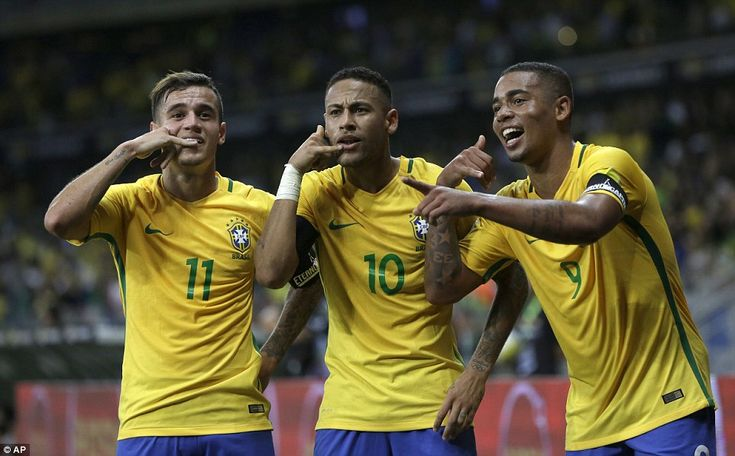 Philippe Coutinho (left) and Gabriel Jesus (right) join Neymar to celebrate Brazil's second goal against Argentina