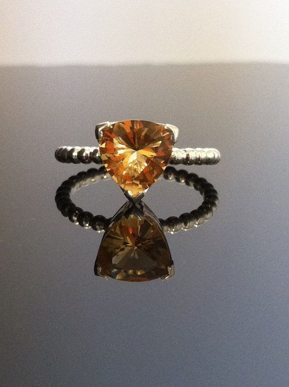 Trillion cut Citrine on a sterling silver band.  by jewellsbyleah