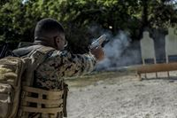 Cpl. Jona R. Meme, a combat camera Marine with the 31st Marine Expeditionary Unit, fires a M45A1 pistol during a range at Camp Hansen, Okinawa, Japan Feb. 27, 2017. As the Marine Corps' only continuously forward-deployed unit, the 31st Marine Expeditionary Unit's air-ground-logistics team range of military operations, from limited combat to humanitarian assistance operations, throughout the Indo-Asia-Pacific region.