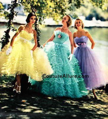 Three strapless tulle dresses by Nadine Formals. The Nadine Formals company was based in St. Louis and is still in business today as part of the Bridal Originals company. These dresses sold in 1957 for $25 - $30 (about $195 - $235 in today's dollar).
