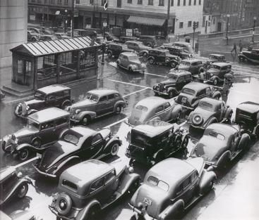 Rush hour traffic piles up at Exchange and Broad on September 30, 1939 as the Times Square Subway kiosk looks on…