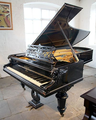 An 1882, Bechstein concert grand piano with a polished, black case and carved griffins on piano cheeks at Besbrode Pianos. This Bechstein piano is the same model that Franz Liszt played. A rare model. £50,000 price includes rebuild.