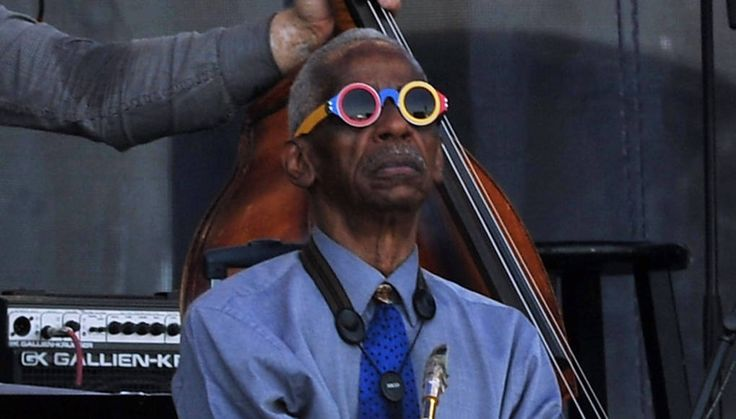 """Saxophonist Roscoe Mitchell listens to a solo on stage during the """"Jack DeJohnette's Made In Chicago"""" performance at the Newport Jazz Festival in Newport, Rhode Island, on Aug. 1, 2015."""