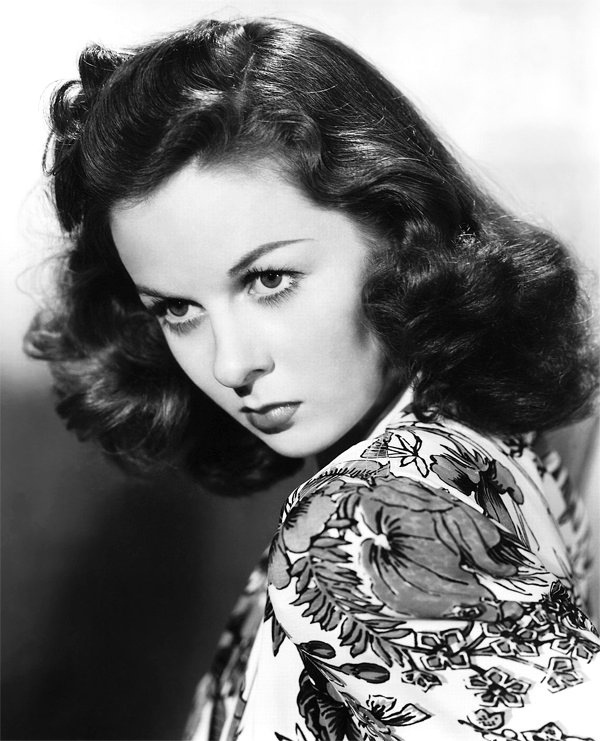 Susan Hayward (she's the master of that sort of tempestuous look)