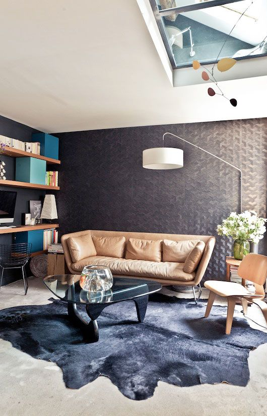 caulder, wall of shelves, wallpaper, coffee table, everything...a flat in paris