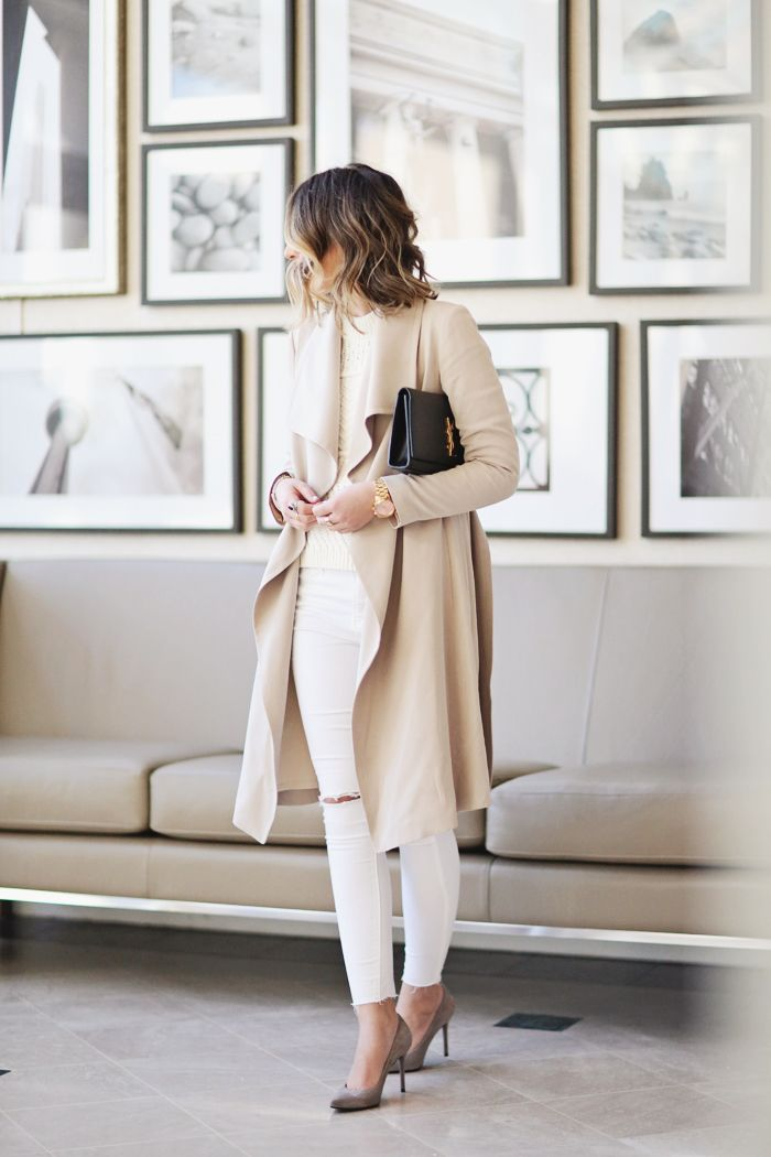 love the outfit, but especially love the gallery wall behind her :)