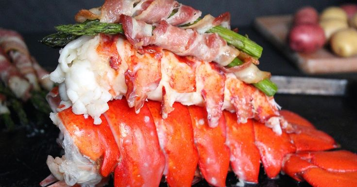 Succulent colossal lobster tail served with bacon wrapped asparagus and a garlicky butter sauce is truly a special meal. I can eat this every week!