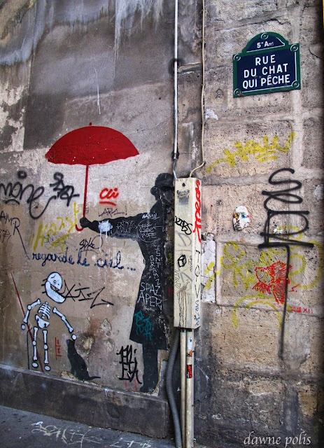 This year I made a point of finding this rue first. Great street art in Paris, Could be by Jeff Aerosol, but more likely by Nemo of Belleville. Rue du Chat-qui-Pêche is considered the narrowest street in Paris. It is only 1.80 m wide for the whole of its 29m length.