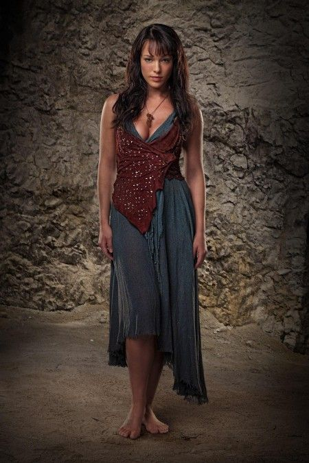 Erin Cummings - In Spartacus as Sura.  She was the first woman who made me feel comfortable in my skin.  Her legs are similar to mine, and she makes them work for her.  I'm built for hard labor and strength :P
