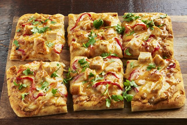 "Skip the ""same-old"" pizza and try our Thai chicken flatbread pizza instead. Topped with peppers, chicken,  mozzarella and a creamy peanut sauce, it's sure to be a hit with the entire family."