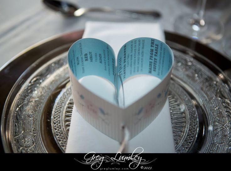 Cute bookmark styled menu shaped into a heart at reception