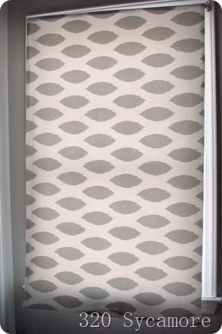 Fabric covered roller window shades.