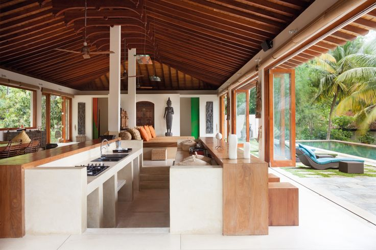 At Kumara Villa—a series of freestanding pavilions—a modern kitchen in the central room opens to a delectable poolside area.