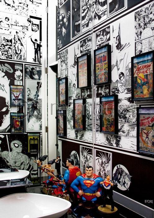 A Superman And Comic Strip Bathroom Books In Frames