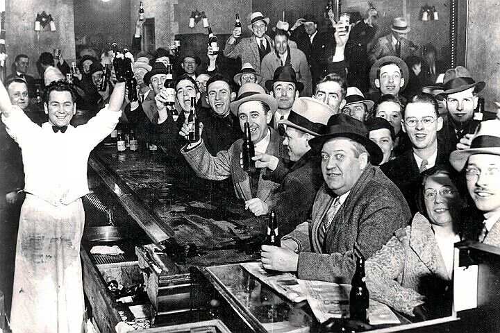 Citizens in a bar celebrate the end of alcohol prohibition in the United States. December 5, 1933.