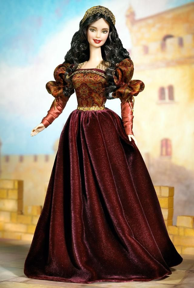 Princess of the Portuguese Empire™ Barbie® doll wears a glorious gown of jacquard and burgundy panne velvet, inspired by Renaissance fashion. A delicate cap of golden metallic lace tops her glorious hair.