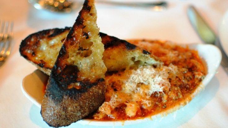 Trippe alla Parmigiana: ricetta di trippe al pomodoro con Parmigiano Reggiano.
